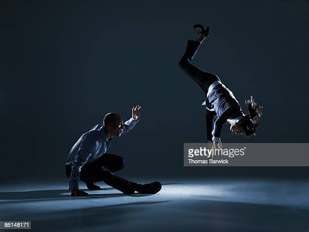 Two businesspeople doing capoeira