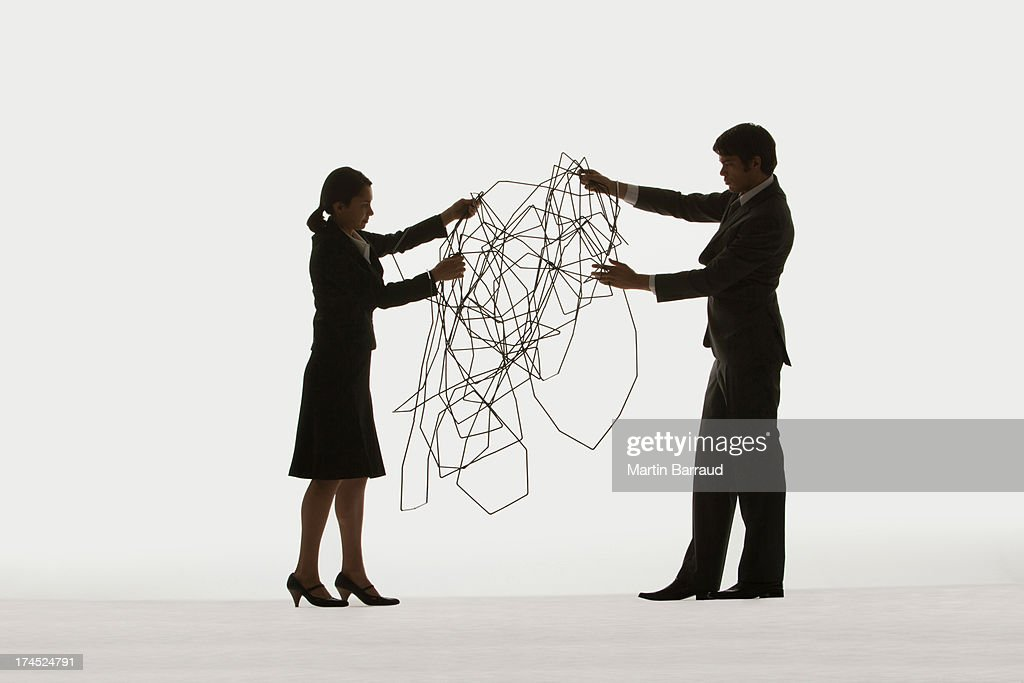 Two businesspeople holding a cable  : Stock Photo