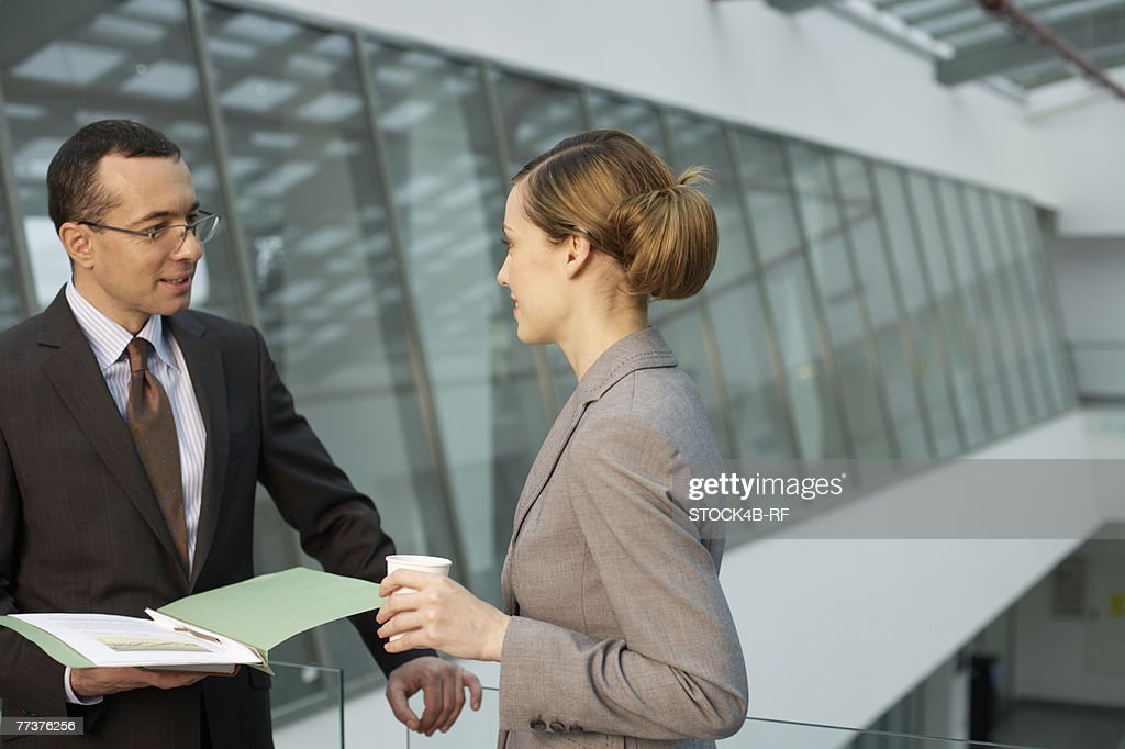 Two businesspeople talking : Photo
