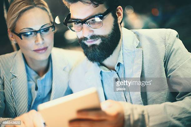 Two businesspeople using digital tablet.