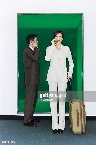 Two Businesspeople Using Mobile Phones