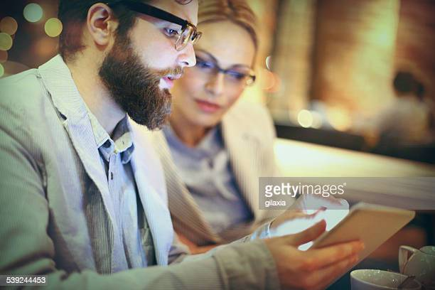 Two businesspeople using tablet.