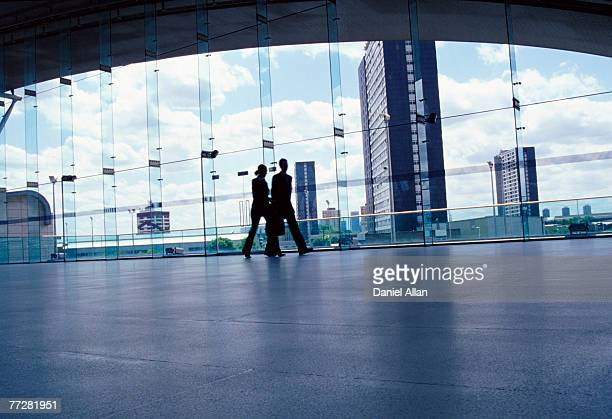 Two businesspeople walking together talking