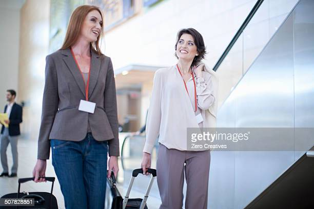 Two businesswoman arriving at conference centre