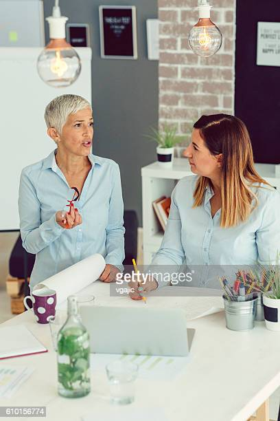 Two Businesswoman Brainstorming