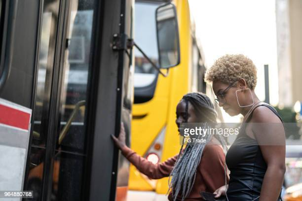 two businesswoman getting on the bus, brazil - brasilia stock pictures, royalty-free photos & images