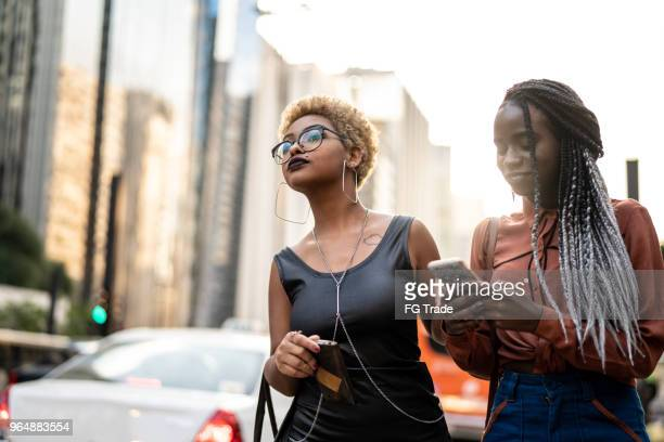 two businesswoman waiting for the transport - car pooling stock photos and pictures