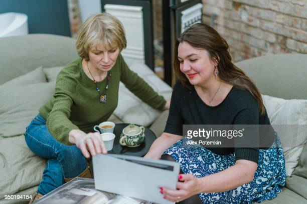 Two businesswomen, 30 years old and 50 years old, discussing some project in the modern freestyle office