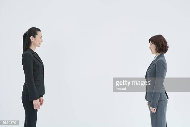 Two businesswomen face to face, profile