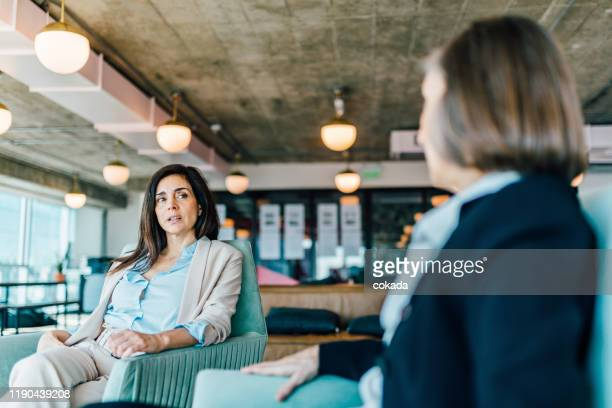 two businesswomen having a meeting - suspicion stock pictures, royalty-free photos & images
