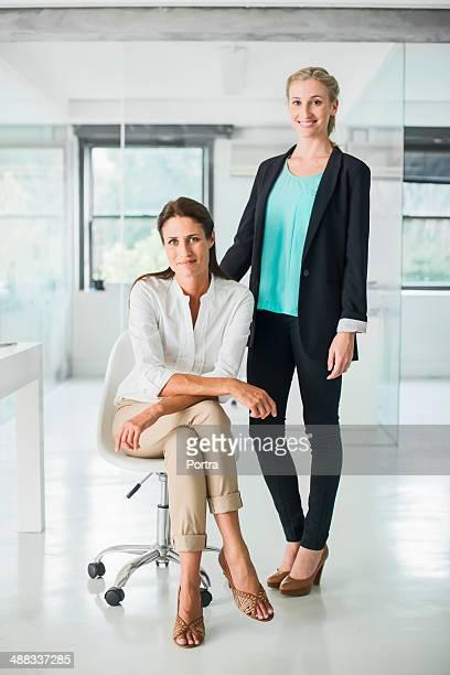 Two businesswomen in a open office