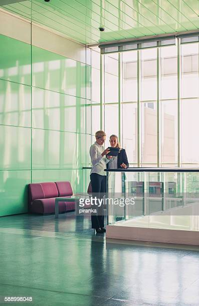 Two businesswomen in the office building