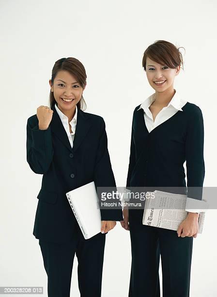 Two businesswomen smiling, portrait