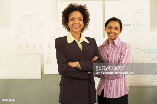 Two businesswomen standing together