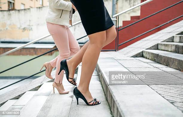 Two businesswomen walking upstairs