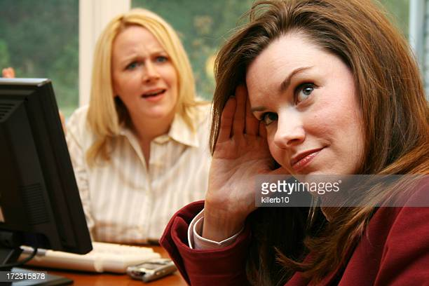 Two businesswomen with facial expressions