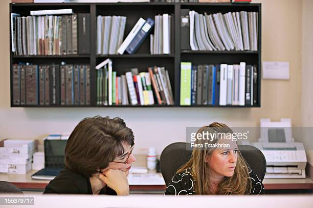Two businesswomen work together