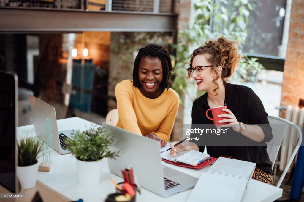 Two Businesswomen Working On Computer In Office : Stock Photo