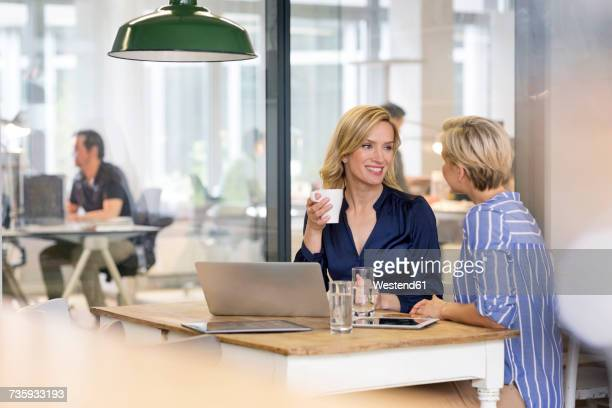 Two businesswomen working together in office