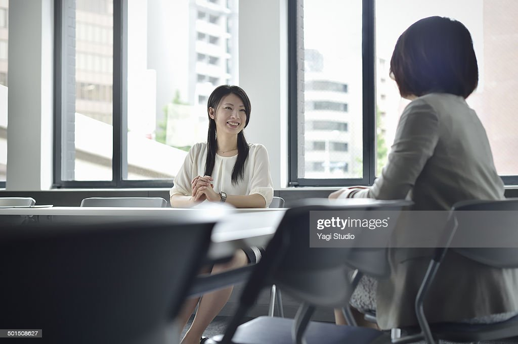 Two busuinessmen having a casual talk in meeting r : Stock Photo