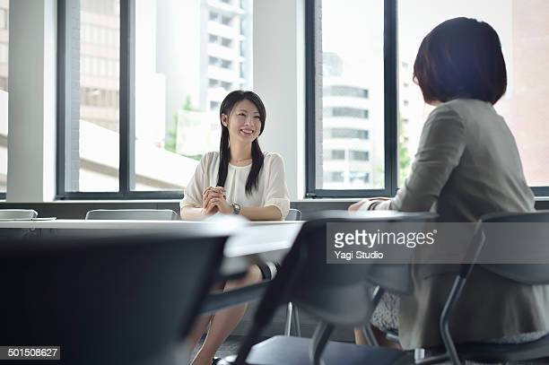 Two busuinessmen having a casual talk in meeting r
