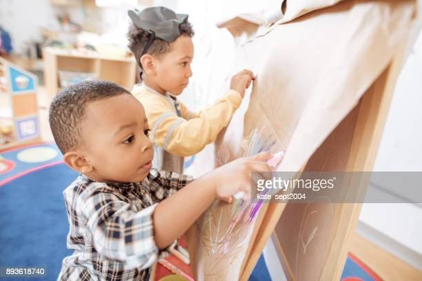 two busy kids - preschool age stock pictures, royalty-free photos & images
