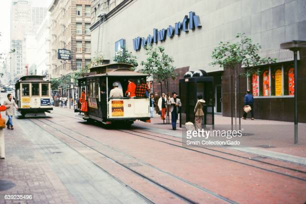Two cable cars pass Woolworth's department store on Powell Street in downtown San Francisco California 1978