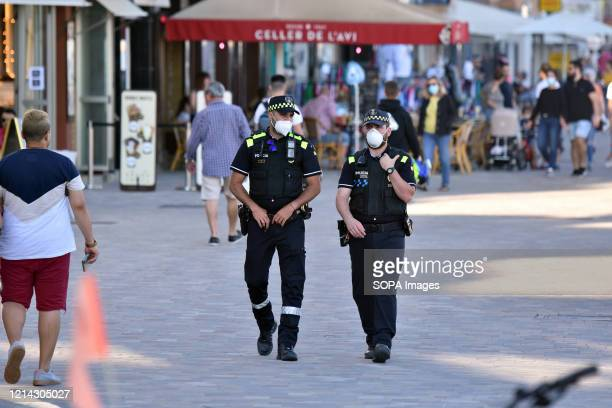 Two Calafell Local Police officers patrol the Paseo Maritimo street to ensure compliance during the end of the confinement of Phase One Calafell is...