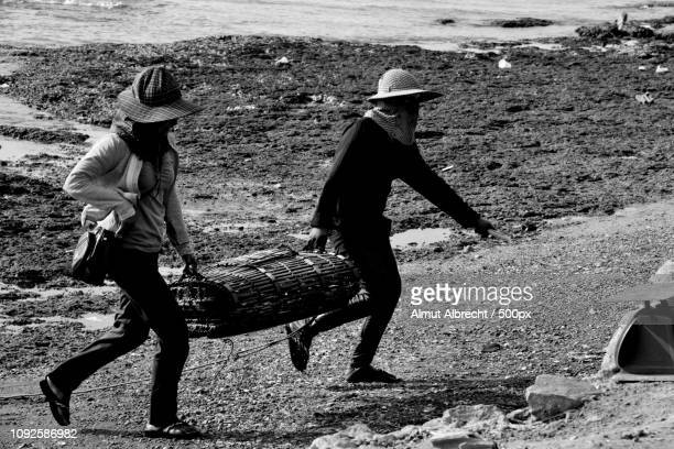 two cambodian women with a basquets for crabs