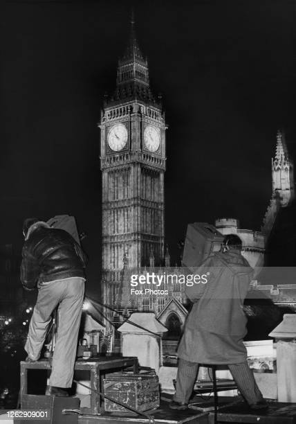 Two cameramen with Marconi television cameras filming Big Ben in the Palace of Westminster in London on New Year's Eve, 31st December 1950.