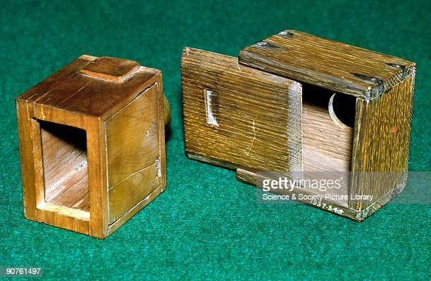 Two cameras associated with the British pioneer of photography W H F Talbot On the left is a small experimental camera with a lens on the right a...