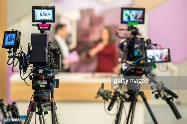 two cameras filming a tv-show - stage set stock pictures, royalty-free photos & images