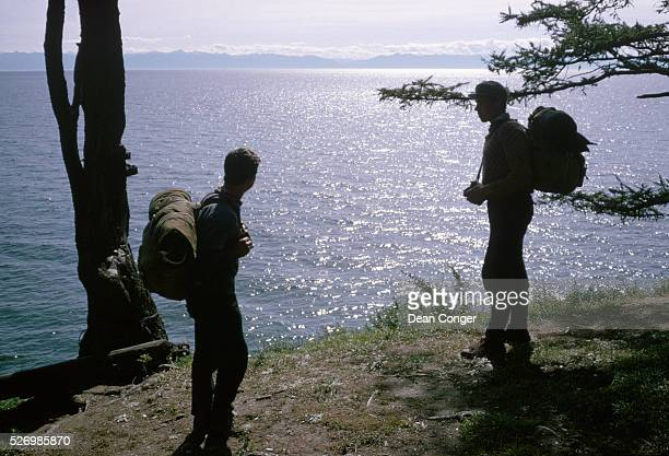 Two campers pause to look across Lake Baikal the world's deepest lake