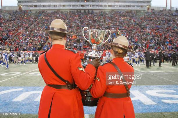 Two Canadian Mounties display the Grey Cup before the 107th Grey Cup Championship Game between the Hamilton Tiger-Cats and Winnipeg Blue Bombers at...