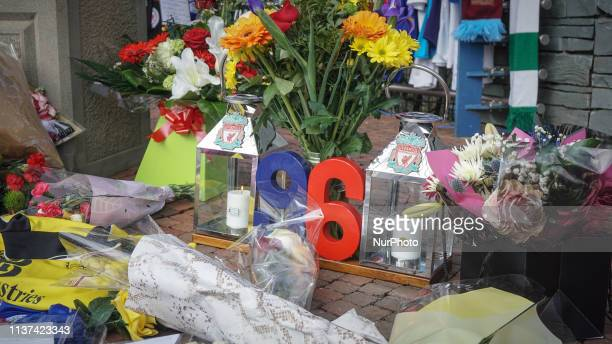 Two candles are seen which formed the number 96 during the memorial service in Sheffield South Yorkshire 15 April 2019 Liverpool supporters and...