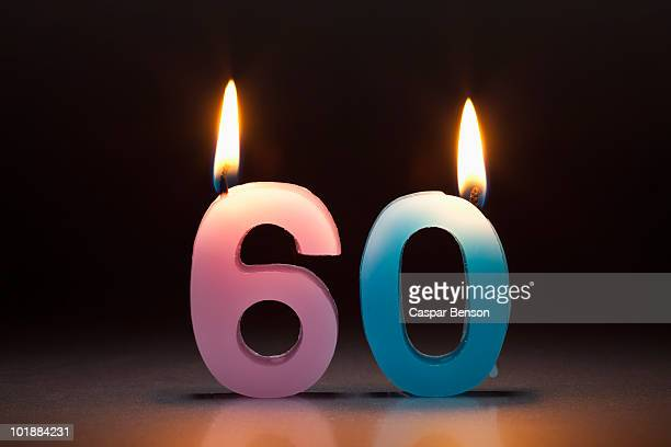 two candles in the shape of the number 60 - number 60 stock photos and pictures