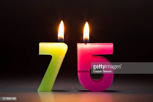 Two Candles In The Shape Of The Number 75