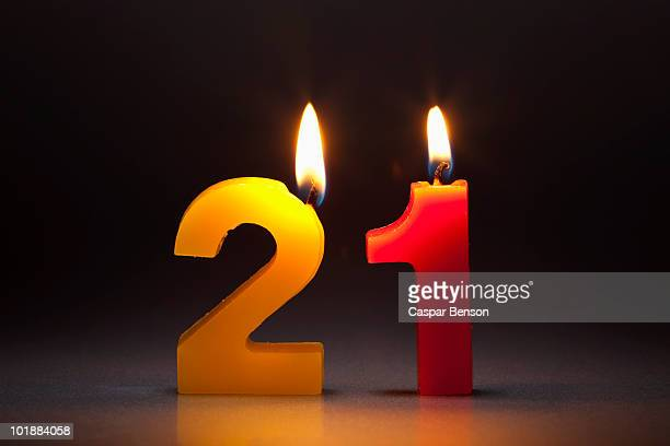 Two Candles In The Shape Of The Numbers 21