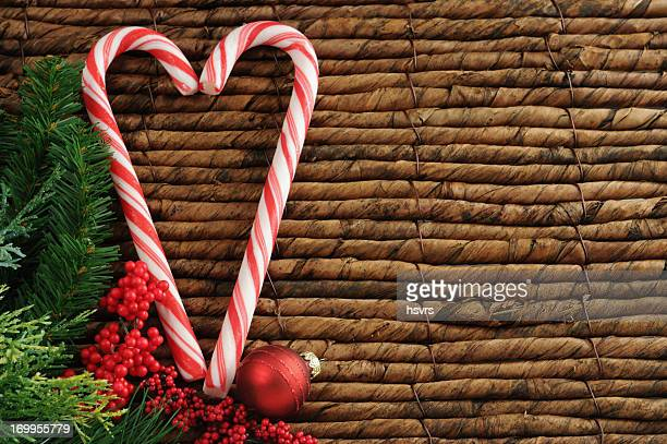 two candy canes with Christmas ornament