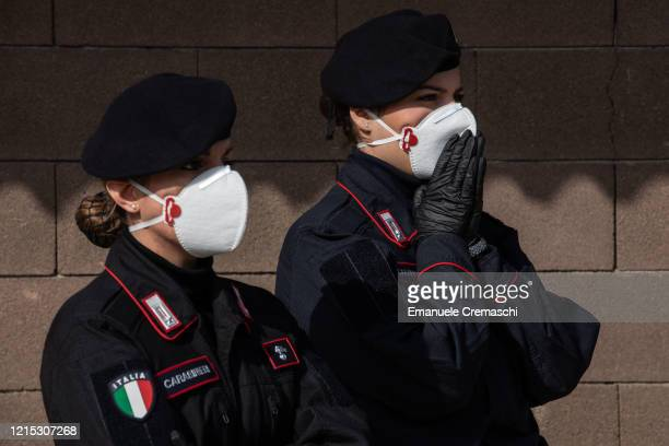 Two Carabinieri officers look on as they take part to an operation to transport coffins on March 28 2020 in Ponte San Pietro near Bergamo Northern...