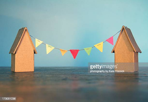 two cardboard houses with  tiny bunting - bunting stock pictures, royalty-free photos & images