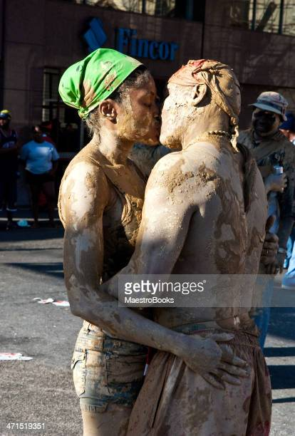 two carnival revellers kissing - trinidad carnival stock pictures, royalty-free photos & images