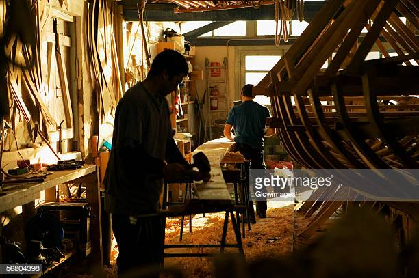 Two carpenters working in a workshop, Spain