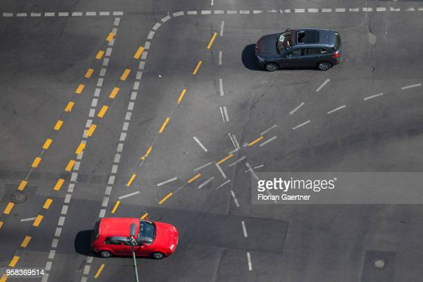 Two cars are pictured on a crossroads with on May 09 2018 in Berlin Germany