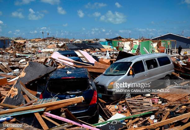 TOPSHOT Two cars are seen in an area destroyed by a storm surge in Marsh Harbour Bahamas on September 10 one week after Hurricane Dorian Bahamas...