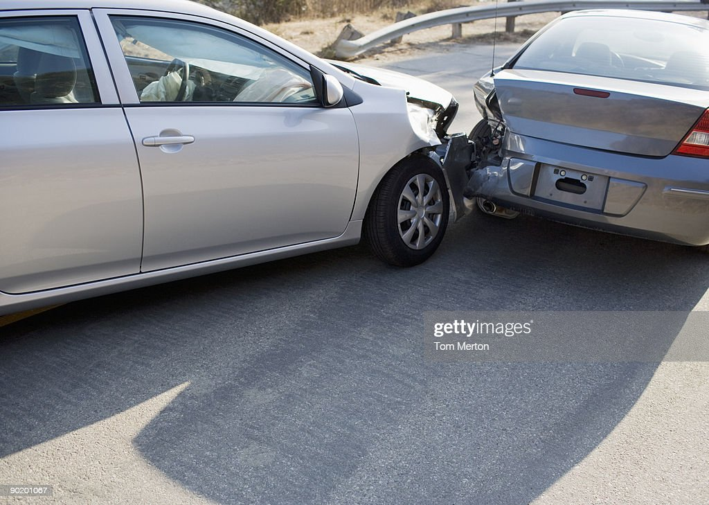Two cars in collision on roadway : Stock Photo
