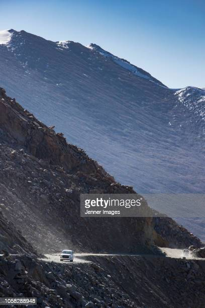 Two cars on the road to Nubra Valley, Ladakh in Himalayan India.