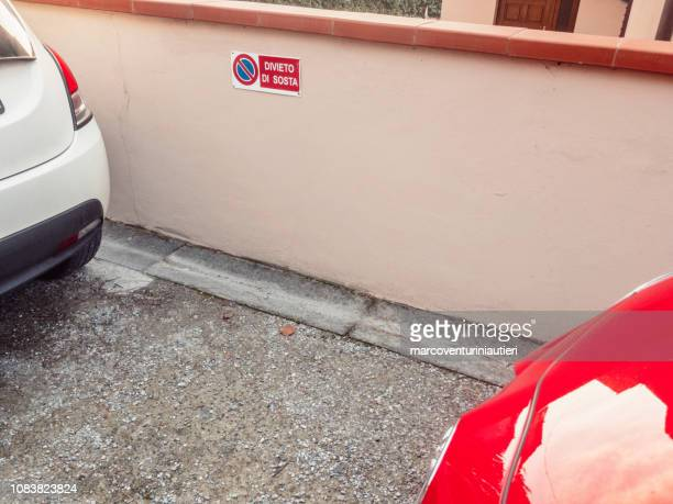 two cars parked in a no parking zone