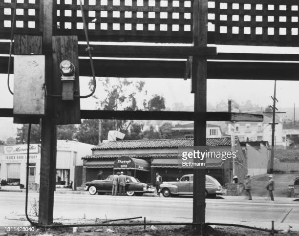 Two cars parked outside Sherry's restaurant on Sunset Strip, a stretch of Sunset Boulevard passing through West Hollywood, California, 1949. On 19th...
