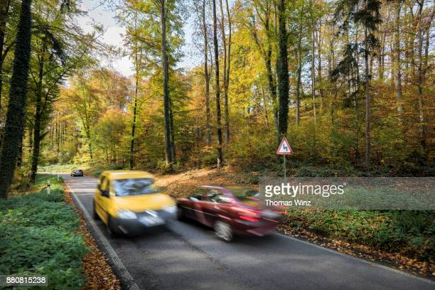 Two cars passing each other , Country road
